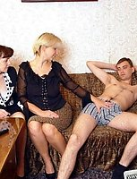 Two mature ladies seduce a young guy