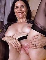 Mature MILF huge boobs nice slit likes dildoes for company