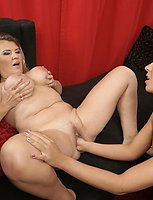 Hot babe licking and fisting a mature lesbian