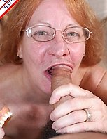 This red mature slut sure loves that cock